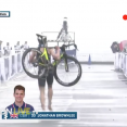 Jonathan Brownlee carries his bike after a crash in WTS Yokohama